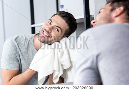 Man Wiping Face With Towel