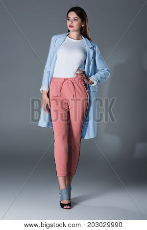Model Posing In Blue Trench