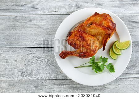 Appetizing Grilled Chicken On White Plate