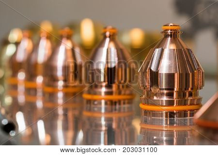 Replaceable nozzles for plasma cutting machine. Spare parts for equipment.