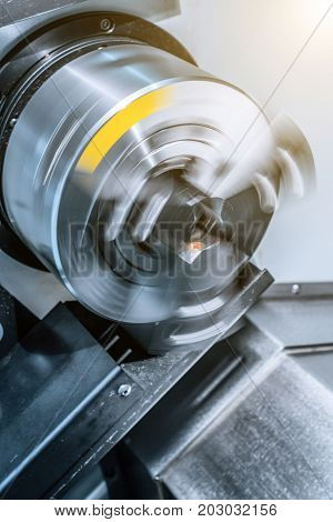 Rotating chuck of CNC lathe. Abstract industrial background.