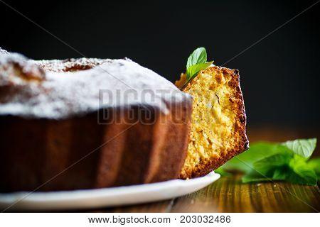 Sweet big honey cake on a white plate