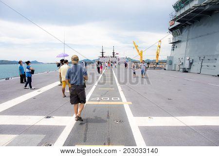 Rayong, Thailand, 13 August 2017: People or traveler visit the battle ship name Chakri Naruebet or Chakrinaruebet at the Royal Thai Navy of Rayong, Thailand.