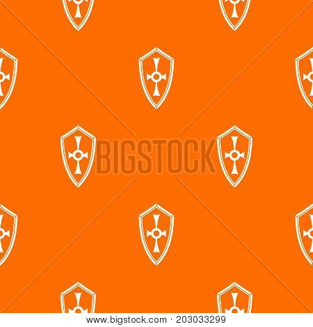 Shield pattern repeat seamless in orange color for any design. Vector geometric illustration