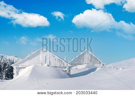 Dramatic wintry scene with snowy house