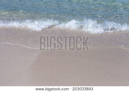 The Soft Wave Of Blue Ocean On Sandy Beach. Background. Selective focus.