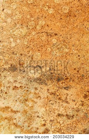 Rusted painted metal wall. Rusty metal background with streaks of rust. Rust stains. The metal surface rusted spots