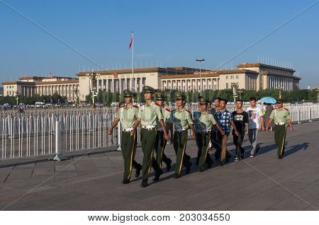 Beijing China - July 28 2012: Guards marching in the Tiananmen Square in the city of Beijing in China