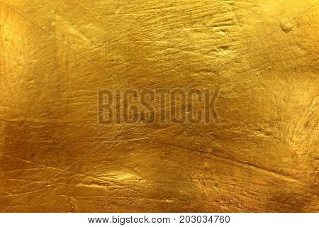 The background of the surface of the golden cement surface is not real.
