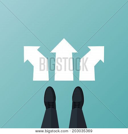 Decide direction. Human standing choice of ways. Shoes on legs of businessman standing in front of arrows. Crossroads arrows. Businessman before choosing. Career path choice or strategy.