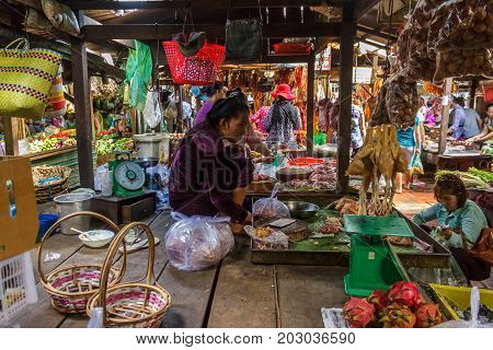 PHNOM PENH CAMBODIA - AUGUST 11 2015: A market vendor waits for customers in the Russian market in Phnom Penh.
