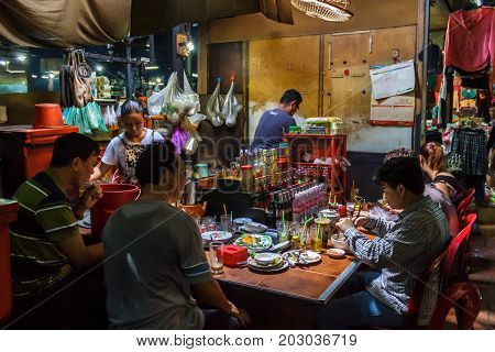 PHNOM PENH CAMBODIA - AUGUST 11 2015: Customers eat lunch in the Russian market in Phnom Penh.