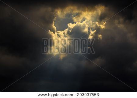 Light of sun from dark clouds like heaven.
