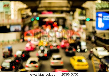 Blurred lines traffic road with bokeh street of town and cars at Bangkok Thailand for travel background or texture - slow life and vintage color style.