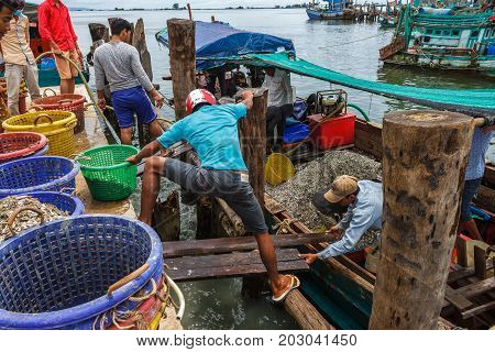 SIHANOUKVILLE CAMBODIA - 7/20/2015: Fishermen prepare for the day in a fishing village.