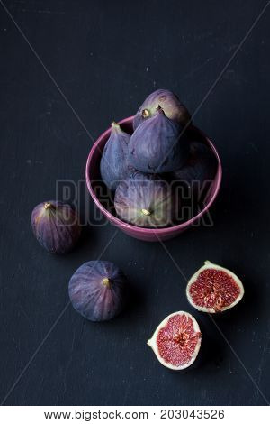 fig fruits on a black background, figs