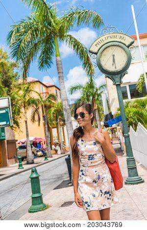 St Maarten woman tourist walking in shopping streets of Philipsburg, Sint Maarten, popular port of call for cruise ship travel destination. Caribbean tropical getaway.