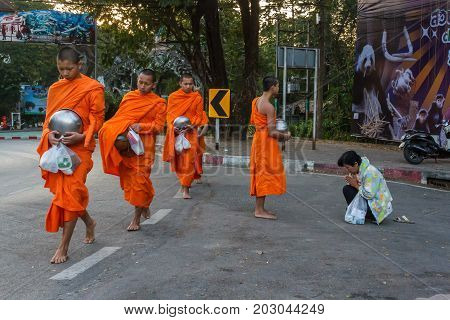 CHIANG MAI THAILAND - 1/8/2016: Monks collect donations in Chiang Mai Thailand.