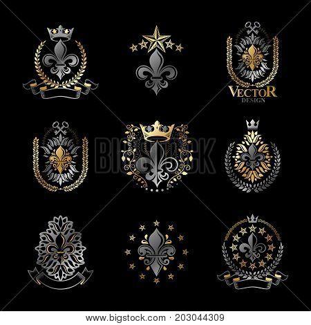 Royal symbols Lily Flowers emblems set. Heraldic vector design elements collection. Retro style label heraldry logo.