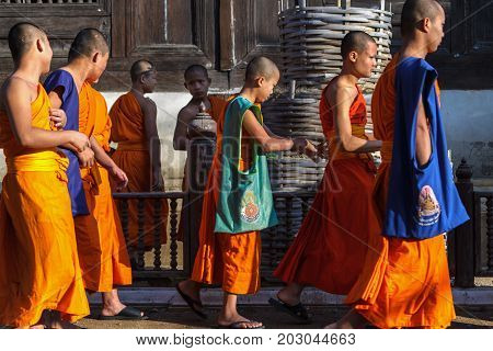 CHIANG MAI THAILAND - 1/29/2016: Novice monks at Wat Prasat temple in Chiang Mai Thailand.