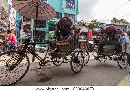 KATHMANDU NEPAL - 9/23/2015: Ricksha taxi drivers wait for customers in the Thamel district of Kathmandu Nepal.