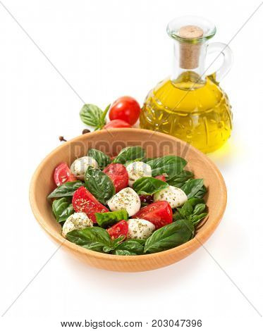 caprese salad in plate isolated on white background