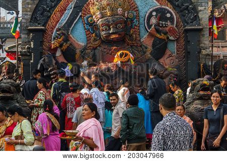 KATHMANDU NEPAL - 9/26/2015: Devotees make offerings at Durbar Square during the Indra Jatra festival in Kathmandu Nepal.