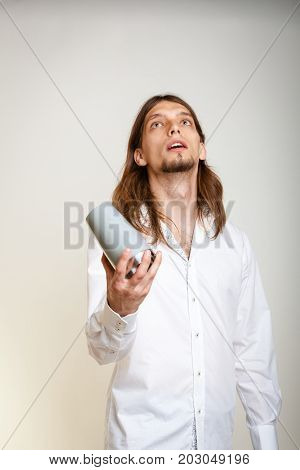 Alcohol liquor drinking party relax concept. Young bartender shaking glasses. Male barman holding glass and shaker preparing mixed beverage.