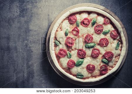 italian pizza at old surface background