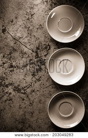 empty plate and saucer at abstract  background