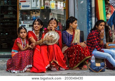POKHARA NEPAL - 11/9/2015: Girls in traditional clothes during the Tihar festival in Pokhara Nepal.