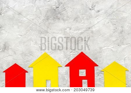 work desk with paper house figures for selling house set stone background top view space for text