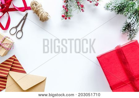 new year 2018 celebration with presents and envelope on white desk background top veiw mock up