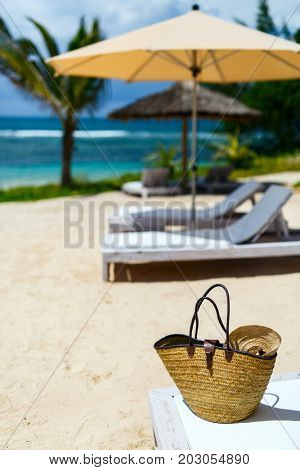 Close up of a straw bag on a tropical beach