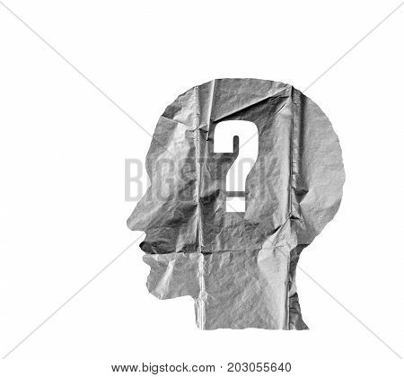 Crumpled paper shaped as a human head and Question mark on white background. Question concept.