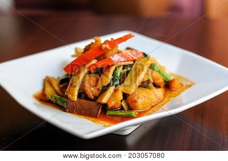 Stir-Fried Spicy Catfish, Stir-fried catfish with curry paste, bamboo shoots, eggplants, bell peppers, basil and green beans
