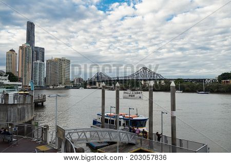 Brisbane, Australia - July 9, 2017: Eagle Street Pier is a retail and restaurant complex, with a ferry terminal, on the Brisbane River.