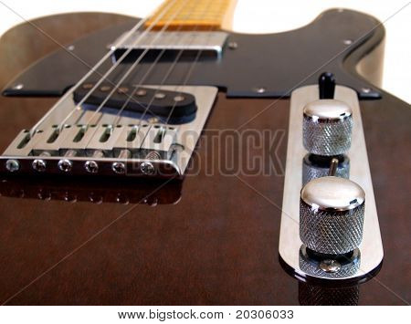 Color photo of electric guitar on white background