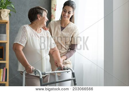 Nurse Helping Senior To Walk