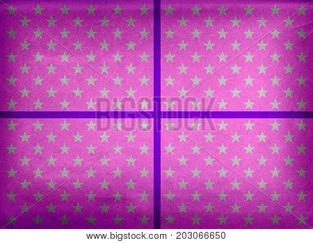 Purple wrapping paper with stars and ribbon