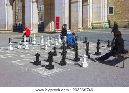 Salzburg, Austria - May 01, 2017: Traditional street chess on central square iin Salzburg is tourists atraction on Salzburg, Austria on May 01, 2017