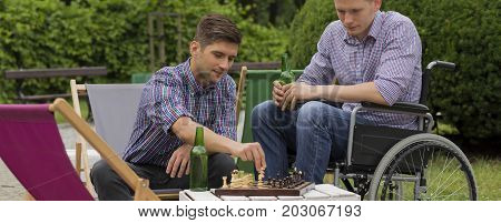 Friends playing chess together in the park