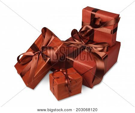Gift boxes group wrapped with brown maroon paper and satin ribbon, isolated on white background. Modern presents for any holiday, christmas, valentine or birthday