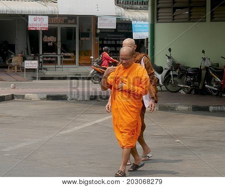 SUKHOTHAI, THAILAND--MARCH 2016: Buddhist monks walk at at the streets of Sukhothai City in the northern part of Thailand.
