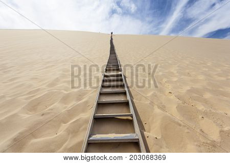 Ladder to the Dune of Pilat - the tallest sand dune in Europe. The dune is located in La Teste-de-Buch in the Arcachon Bay area France