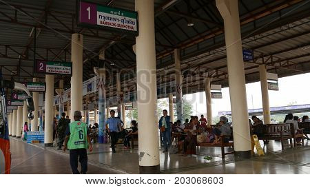 SUKHOTHAI CITY, THAILAND--People waiting for buses at the Sukhothai Bus Terminal in Sukhothai City, northern Thailand in March 2016.