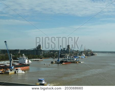 NEW ORLEANS, LOUISIANA--JANUARY 2017: Barges and cargo vessels at the Mississippi River in New Orleans, Louisiana on a cold morning.