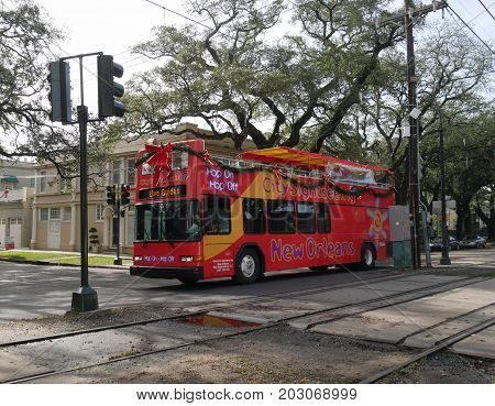NEW ORLEANS, LOUISIANA--A Hop On, Hop Off city sightseeing bus traveling along St. Charles Street in New Orleans in January 2017.