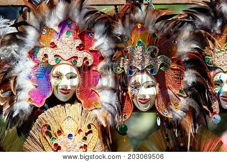 Masks of different attractive colors and feathers on display at the Kadayawan Festival in the streets of Davao City, Philippines in August each year.