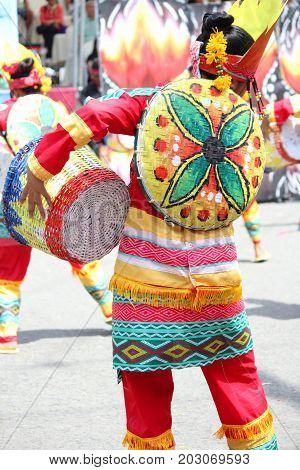 DAVAO CITY, PHILIPPINES--AUGUST 2014: Colorful costumes is one attraction to the parade each year. Kadayawan is celebrated August each year to give thanks for life and an abundant harvest.
